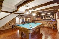 Entertainment room with pool table and castle theme design