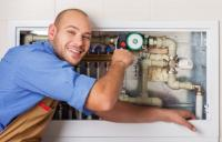 Professional plumber checking pipes