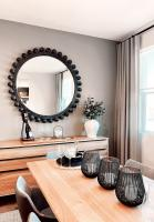 Dining room buffet table with big round mirror