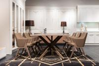 Dining room table with dark rug underneath