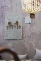 Dining room with boho-chic inspired wallpaper