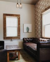 Dining room with brown patterned wallpaper