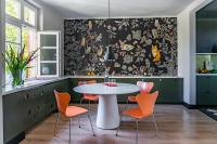 Dining room with detailed floral wallpaper