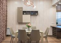 Dining room with neutral color textured wallpaper