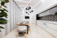Dining room with wallpaper with white curved lines
