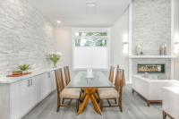 Dining room with white rock walls and no wallpaper