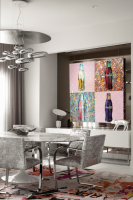 Dining room with large multicolor rug under the table