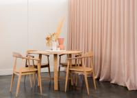 Dining room with long curtains
