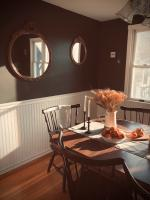 Dining room with mirrors on the wall