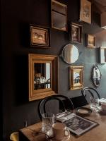 Black wall with vintage mirrors