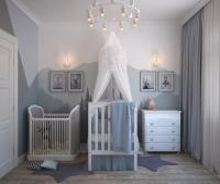 Blue nursery room with white crib and blue blanket