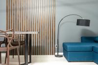 Blue sofa and wood panel on a light blue wall