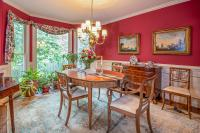 Bright red two tone dining room with white chair rail