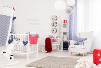 Bright white nursery with armchair and crib