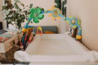 Changing table with baby mobile arch