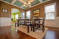 Dining table with dark wood chairs