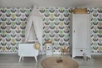 Flower wallpaper with white crib and furniture