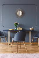 Gray accent wall with dark chairs