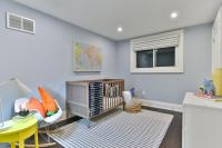 Light blue room with orange plush toys and map