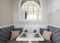 Dining room with neutral colored walls and white chair rail