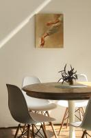 Neutral walls and dining table with painting on the wall