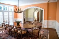 Peach orange walls and dining table