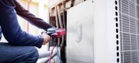 Person checking air conditioning system