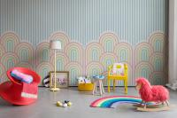 Nursery with rainbow wallpaper with colorful objects