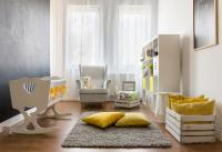 Nursery with crib and plush toy and yellow cushions