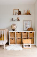 Nursery with wooden furniture and fluffy rug