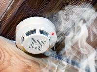 Smoke detector on wooden ceiling