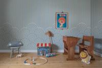 Striped blue wallpaper with toys and a lion picture