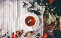 Teacup on tablecloth with leaves
