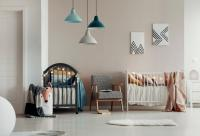 Twin nursery with chair and hanging lamps