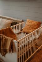 Warm tanned colors and a wooden crib