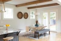 White walls dining table and gray bench