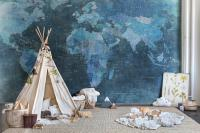 Nursery with a world map wallpaper and teepee