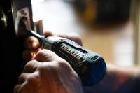 Using a cordless drill to repair a door