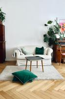 Coffee table with green floor cushions
