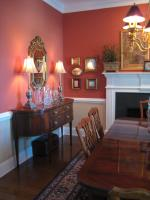 Dining room with deep red and ran colors