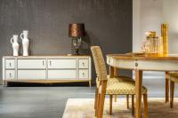 Dining room with gold and gray colors