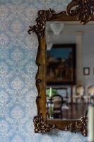 dining room mirror on vintage mural wall