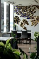 Dining room mural of large black and gold leaves