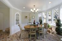 Dining room with pale green and crisp white colors