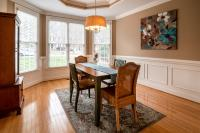 Dining room with rich brown and white colors