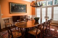 dining room with tangerine orange and off white colors