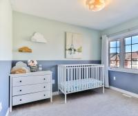 nursery layout with blue walls and white furniture