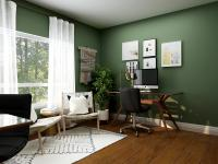 Office space with green walls and a large window