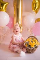 Baby girl with pink and yellow decoration