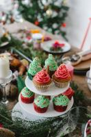 Christmas green and red cupcakes topped with sprinkles